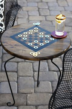 Designer Bethany DeVore of Dwellings by DeVore created this DIY side table and checkers board for her patio makeover. She explains how she made it on The Home Depot Blog. || @dwellingsbydev