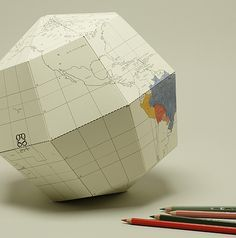 """paper sectional globe tilted to """"earth's axis, 23.4 degrees."""""""