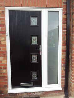 Open black GRP contemporary door from Everest shown from a front ...