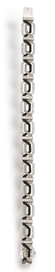 An onyx, rock crystal and diamond bracelet  designed as interwoven geometric lines of frosted rock crystal, onyx and round brilliant-cut diamonds; signed; estimated total diamond weight: 1.75 carats; mounted in eighteen karat white gold; length: 7in.
