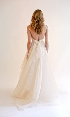 Long Wedding Dress, Tulle Wedding Dress, Backless Bridal Dress, Simple Design Wedding Dress, Floor-Length Wedding Dress, Sleeveless Wedding Dress, V-Neck Wedding Dress, LB0656 The Wedding Dresses?are?fully lined, 8?bones in the bodice, chest pad in the bust, lace up back or zipper back are all available. This dress could be custom made, there are no extra cost to do custom size and color. Description? 1, Material: tulle, elastic silk like?satin, pongee. 2, Color: there are many?colors are…