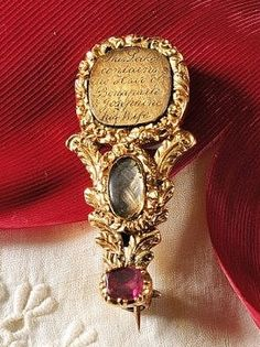 """A Haley's Comet pin commemorating Napoleon and Josephine, the inscription reads """"This locket contains the hair of Bonaparte and his wife Josephine"""".  Probably from about 1820"""