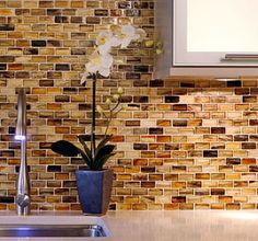 Glass back splash, love the colors - would go great with the new pendants we bought!