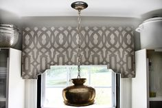the HUNTED INTERIOR: DIY Stenciled Cornice Board between two cabinets with pendant light in a kitchen window Bathroom Window Treatments, Bathroom Windows, Kitchen Sink Window, Kitchen Windows, Kitchen Cornice, Diy Kitchen, Room Kitchen, Kitchen Cabinets, Window Cornices