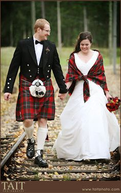 Groom wearing a kilt, and the bride has a shrug that is in the same color of tartan. Very good idea, since he has said he wants to wear a kilt when we get married. Celtic Wedding, Irish Wedding, Wedding Men, On Your Wedding Day, Wedding Suits, Wedding Attire, Wedding Ideas, Kilt Wedding, Tartan Wedding Dress
