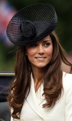 2011 Trooping the Colour event - the Duchess paired her ivory Alexander McQueen coat with an oversized Lock & Co. hat.