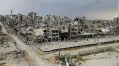 Destroyed buildings are seen in Homs, Syria, on Saturday, May 10, after an evacuation truce went into effect days earlier. Thousands of disp...