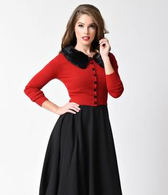 The appeal is real, dames. The perfect cover-up for cooler days, the Pietra red cardigan from Collectif is a soft knit separate with sleek three-quarter sleeves, darling black heart buttons and a gorgeous removable black faux fur collar. Thick, ribbed sta