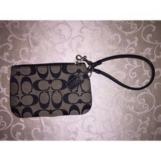 """Coach Grey & Black Wristlet Grey Coach Wristlet trimmed in Black with Black """"C's"""" 6inches long Coach Bags Clutches & Wristlets"""