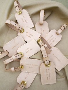 Personalize them for your bridesmaid and groomsmen!  How great for a destination wedding!  leather luggage tags via Calder Clark Designs blog