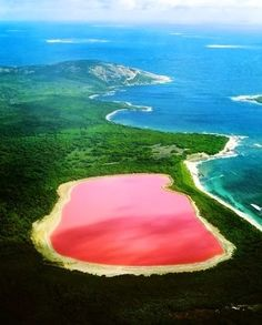 Lake Hillier, is a lake on Middle Island, the largest of the islands and islets that make up the Recherche Archipelago, Western Australia. The most notable feature of the lake is its pink colour. It is such a significant distinguishing feature of the archipelago that air passengers often take note of it. The color is permanent, and does not alter when the water is taken in a container.