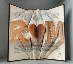 A folded book art with Any 2 initials of your choice and a heart in between. Please leave me a message of the initials while check out.  A❤B❤C❤D❤E❤F❤G❤H❤I❤J❤K❤L❤M❤N❤O❤P❤Q❤R❤S❤T❤U❤V❤W❤X❤Y❤Z  Please do not request any specific book.Not every book is suitable for this folded book. I choose book base on pages and thickness. I bought most of my books from local libraries/charities and put a new life on them. Books are chosen randomly(mainly are novels, biography..) I do try my best to avoid i...