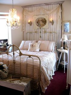 Cozy bedroom. Love the chandelier and the beadboard panel behind the bed. Very romantic.