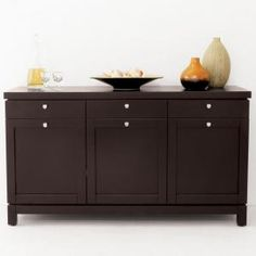 good example of drawers on top, door below.  I like the door pull located directly below the drawer pull