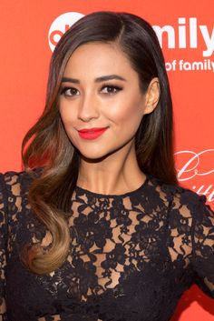 If you're wearing a red-orange lipstick, try a blush with more of a grey or brown tone in it to contour, like Shay Mitchell.
