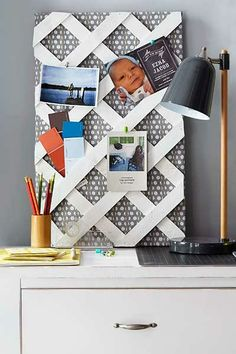 Cut a piece of plywood to size and cover it with batting and fabric. Secure with a staple gun. Tack a piece of lattice on top with brad nails. Tuck paint swatches and the like into the openings. | Photo: Laura Moss | thisoldhouse.com