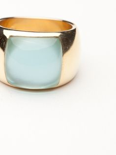 The design of this ring offers a modern silhouette with yellow gold making up the shank. A square shaped blue topaz stone is set into the band over mother of pearl, which gives the stone a milky and mystical look. Topaz Jewelry, Jewellery, Online Boutique Stores, Blue Topaz Stone, Family Jewels, Band Rings, Gemstone Rings, Jewelry Design, Bling