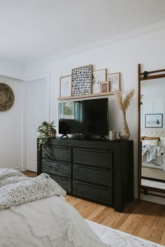 How To Decorate Around a TV. How I decorated around our TV while still shopping my house and not spending any money. Two different options to decorate Home Decor Bedroom, Decor, Master Bedroom Makeover, Bedroom Interior, Bedroom Makeover, Tv In Bedroom, Dresser Decor Bedroom, Bedroom Tv Wall, Apartment Decor