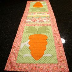 A white rabbit peeks out from behind a giant carrot at each end of this table runner. Description from etsy.com. I searched for this on bing.com/images