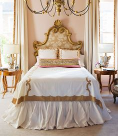 "In a New Orleans home, the master bedroom's feminine mystique starts with something old: an antique headboard designer Melissa Rufty found at Bush Antiques just after graduating from Tulane. ""It's so New Orleans, so sexy,"" she says. ""I imagine it's from some French hotel."" Bed linens reminiscent of Old Paris porcelains are by Leontine Linens.   - HouseBeautiful.com"