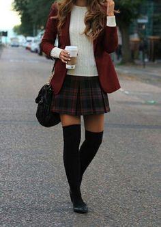 Rust-orange blazer + plaid skirt.