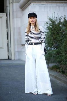 Black and white Breton stripes may seem just as stereotypically French as berets (ever been a mime for Halloween?) but modern iterations keep the trend fresh, especially when it's paired with unexpected pieces like wide-leg pants.   - HarpersBAZAAR.com