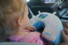 www.Snuggwugg.com If you are looking for a great baby product that you can use for diaper changes, tummy time play and travel you will LOVE Snuggwugg. Snuggwugg grows with your baby .  Matilda loving her Snuggwugg in her car seat. Use it with video player, smartphone, put toys in the pocket or loops. Grows with baby. Use Snuggwugg for diaper changing when they are little and in car seats and travel as toddlers.  Snuggwugg Multi-Use Smartphone Interactive Pillow grab yours here…