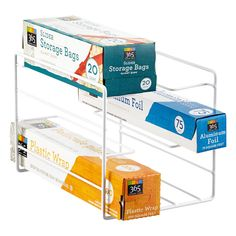 """""""Roll Call"""" is now easier thanks to our Kitchen Wrap Organizer.  Keep six rolls of plastic wrap, foil, plastic bags, and waxed paper present and accounted for.  This organizer requires no mounting."""