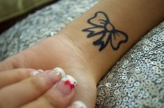 I'm obsessed with bows!  Would love to get a small bow tattoo like this - if I had the guts. .
