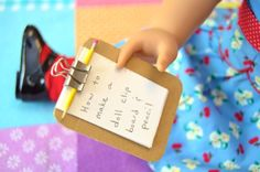 How to Make a Doll Clipboard and Pencil Set Miniature Clipboard and Pencil Set for a Doll. Cute idea for a Doll Birthday Party theme to give as party favors. year old girls enjoy writing notes that their doll can hold. Very easy to do with minimal comp American Girl Outfits, My American Girl Doll, American Girl Crafts, American Girl Birthday, American Girl Parties, Ag Dolls, Girl Dolls, Ag Doll Crafts, American Girl Accessories