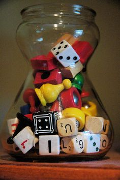 Jar full of game pieces and old dice - cute decoration for the family room/game room. Love this idea for all the odd pieces you find but dont remember what game they went to.