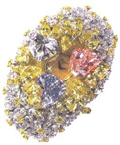 This watch by Chopard features three heart-shaped diamonds, the pink weighs 15 carats, the blue weighs 12 carats and the white weighs 11 carats. They are set in a bracelet encrusted with clusters of white pear-shaped diamonds arrange in flower motifs, with a yellow diamond standing up from the center of each. Total caratweight of the white and yellow diamonds is 163 carats, while the total caratweight of the watch is 201 carats.
