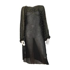 Halston 70s black silk beaded dress size 8 / 10.    From a collection of rare vintage evening dresses at https://www.1stdibs.com/fashion/clothing/evening-dresses/ @1stdibscom @Halston #Halston #vintage #fashion #70s #shopping #luxury