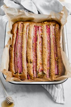 A rustic rhubarb almond honey cake with a hint of orange zest and wildflower honey. A perfect one-bowl snack cake ready in just 45 minutes! Köstliche Desserts, Delicious Desserts, Dessert Recipes, Yummy Food, Yummy Recipes, Cake Recipes, Rhubarb Bread, Cooking Rhubarb, Broma Bakery