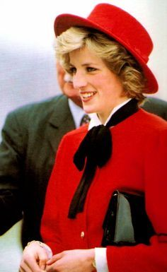 The Princess of Wales wearing red with black and white accents.