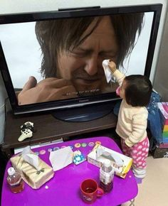 cute kid wipes tears for the people on the TV