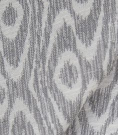 """Medina, Silver Fabric from Tonic Living: woven upholstery fabric in a medium grey and natural cream which is suitable for medium to heavy upholstery, pillows, cushions and foam benches.  Manufacturer recommends dry clean only. Double Rubs: 15,000  56"""" wide 100% Polyester $24.96 per yard"""