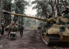 Tiger II at Normandy. British POWs hauling food for the tank crews.