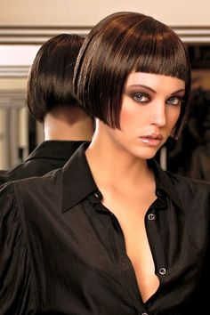 Short dark bob with fringe with shaped, clippered nape.