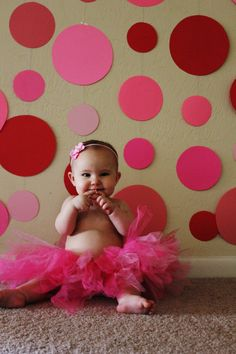 #baby #photography Make a fun backdrop with colored paper circles hung on string for baby photos and Valentine's Day.