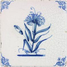 Antique Dutch Delft tile in blue with a Dandelion flower, 18th century