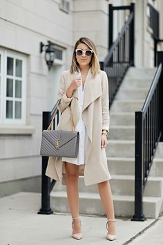 49655c2a2a5 Neutral Outfits   Ideas  Stephanie Sterjovski is wearing a beige Club  Monaco trench coat with a creme Aritzia dress and 424 Fifth pink heels