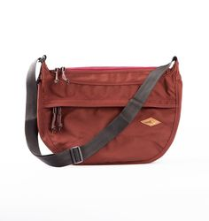 Maroon Bota HipBag by Gravity Element. With14 oz (407 gr/m2) water repellent polyester canvas, waterproof parachute inner lining, YKK zipper closure. Also with dimension37 cm width,12 cm depth, and24 cm height. The bag has1 front pocket with zipper closure, 1 main zipper compartment, 1 mesh zipper pocket inside, and 1 rear pocket with button closure. http://www.zocko.com/z/JJfw9