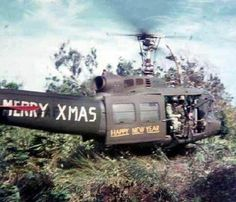 Huey X-mas. Viet Nam 1970-1971. An infantryman in Vietnam - by Army photographer Charlie Haughey who served in Vietnam and packed away his photos in a shoebox for decades. Those images were recently pulled out and printed for display.