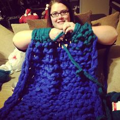 Arm knitted a blanket. Used simply Maggie's tutorial on knitting a scarf. 12 Skeens of yarn, 15 stitches. Amazing!