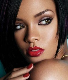 Love the dark eyeliner paired with a deep-pinkish-red lip.  Powerful without being overpowering.