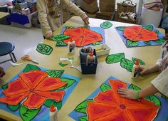 O'Keeffe flowers: Paper and tempera. I'd love to see kids each get a different flower. When you glue it, have styrofoam stickes to give a 3D look