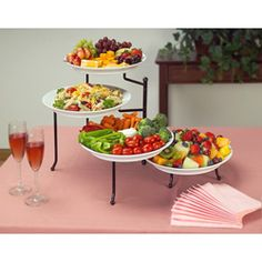 @Overstock.com - Adjustable 4-tier Buffet Server - Make any occasion an elegant affair with this professional food presenterRemovable ceramic plates nest in a sturdy stand ideal for presentation of foodFour-tier buffet server features four white serving plates on a steel stand 12.5 inches high  http://www.overstock.com/Home-Garden/Adjustable-4-tier-Buffet-Server/3153319/product.html?CID=214117 $64.99