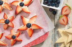 Fresh berries, pressed atop generously frosted star-shaped cookies. What an easy way to create a stunning summertime dessert!