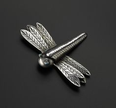Sterling silver dragonfly brooch with four wings, tapered body and turquoise eyes, stamped throughout: USA, New Mexico, Navajo, maker unknown, c. 1940s